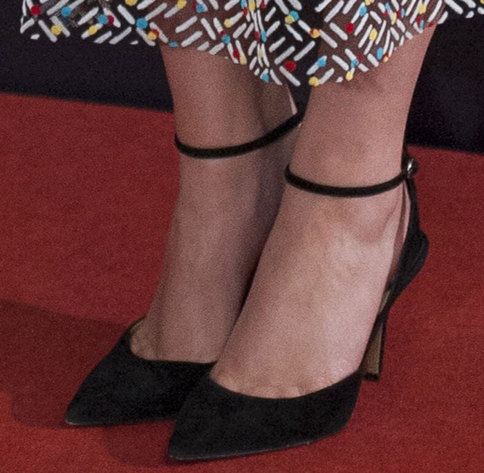 Emma Watson shows off her feet in black shoes