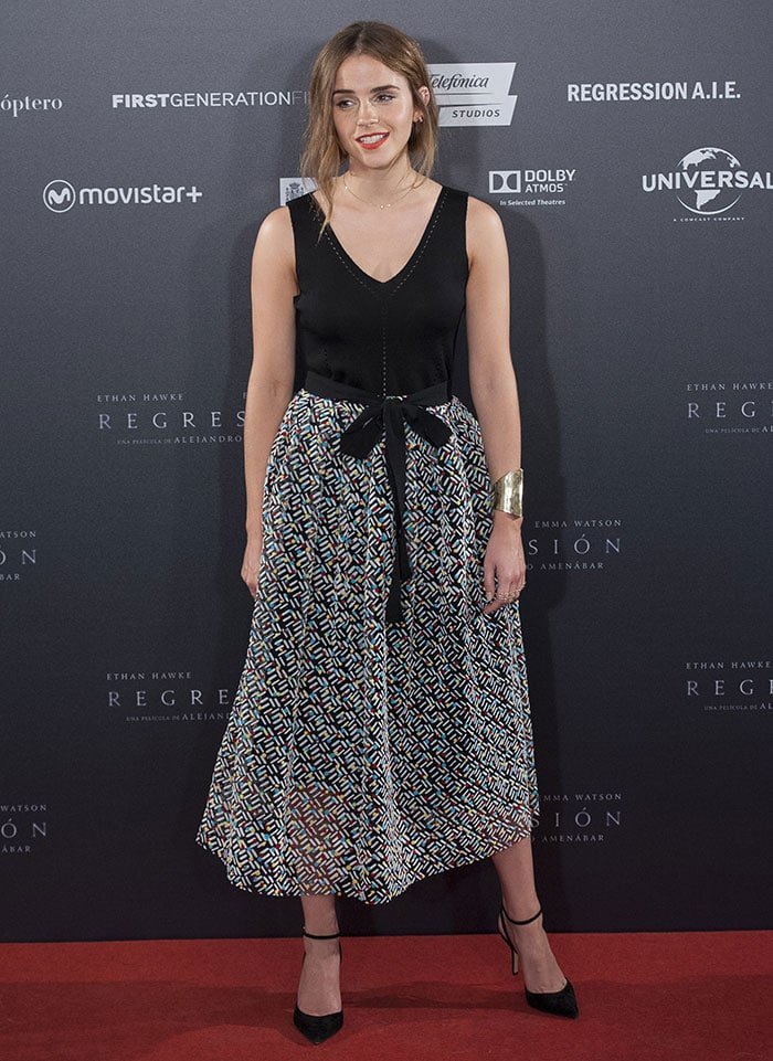 Emma Watson wore a knitted black V-neck top and a multicolored patterned tulle skirt