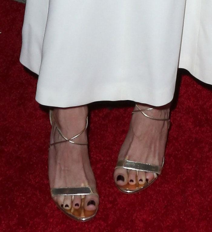 Emmy Rossum showed off her pretty feet in Aquazzura's Linda sandals
