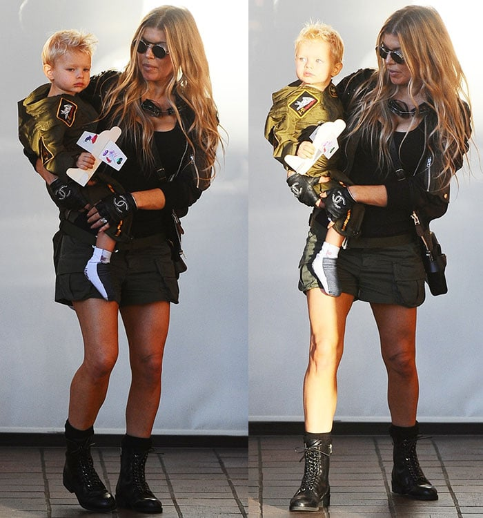 Fergie carries her son, Axl, as the two arrive at Chin Chin restaurant for a party in honor of Axl's second birthday