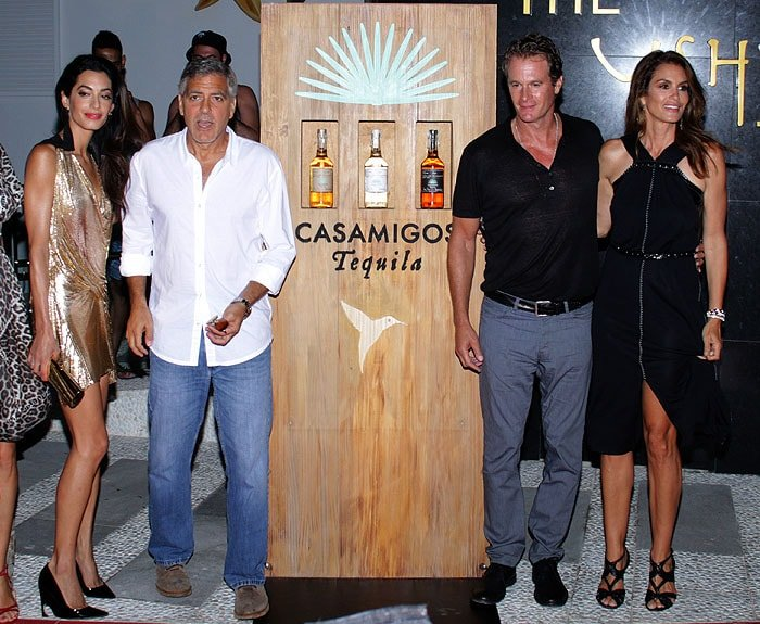 Husband-and-wife business partners: Amal and George Clooney posing with Rande Gerber and Cindy Crawford