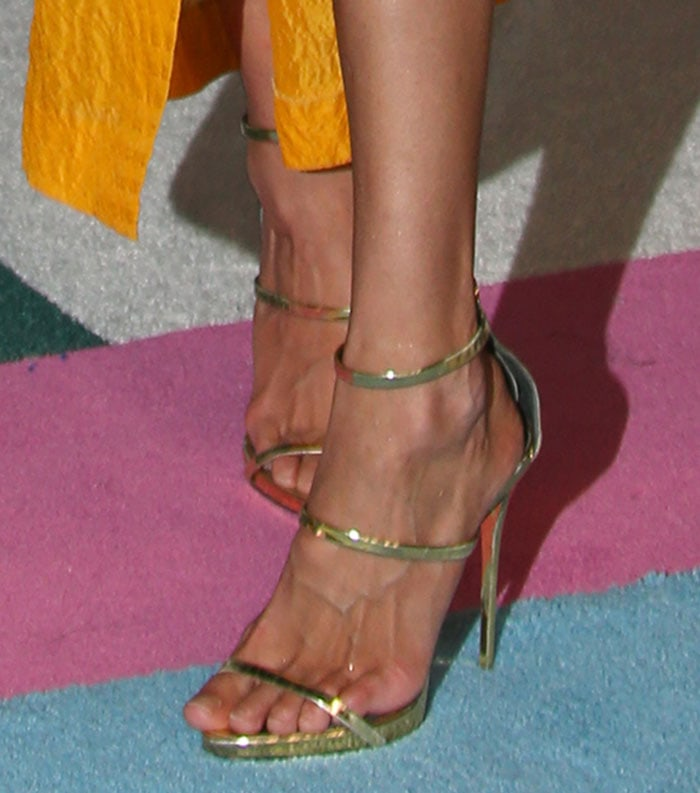 Gigi Hadid crams her feet into a pair of Giuseppe Zanotti sandals