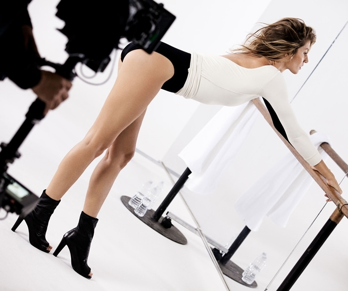 Gisele Bundchen's short brown hair flies backward as she poses during a commercial shoot