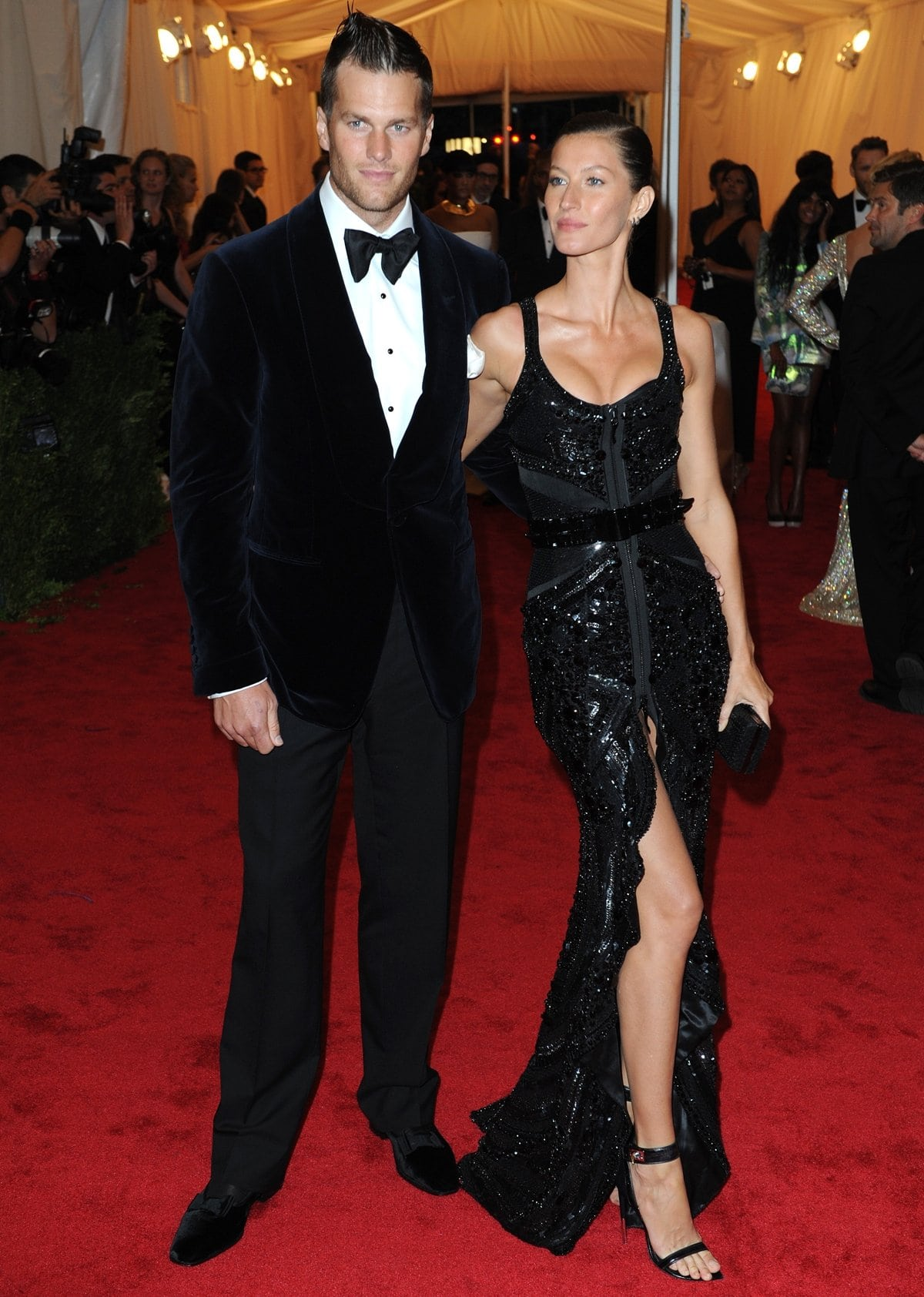 Gisele Bündchen in a dramatic sleeveless sexy black Givenchy dress and Tom Brady in a Tom Ford suit at the 2012 Met Gala