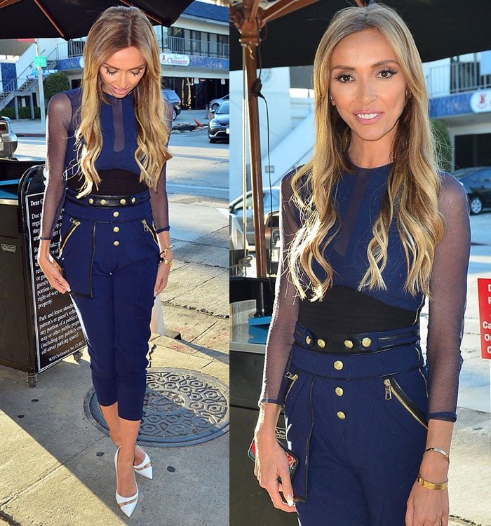 Giuliana Rancic accessorized with gold bangles to match the stud accents on her suit and finished off the look with a pair of white pumps