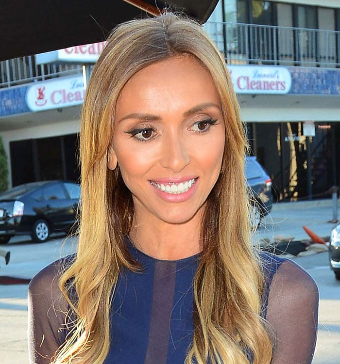 Giuliana Rancic styled her hair in loose waves around her shoulders and wore cat-eye makeup and pink lipstick