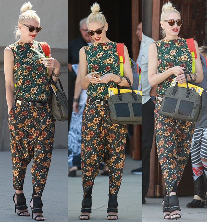 Gwen Stefani finishes off her outfit with black accessories, including a handbag and stilettos