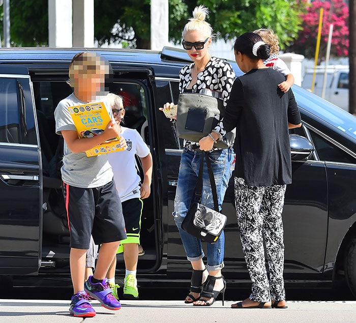 Gwen Stefani dons high heels and takes her three sons to a church in Los Angeles