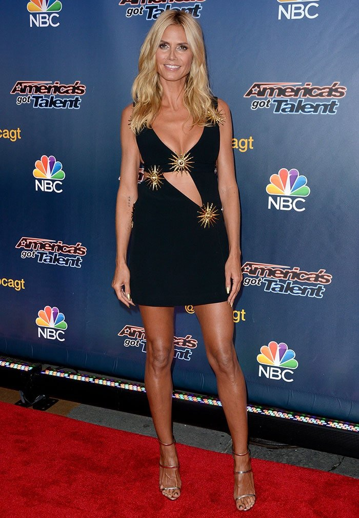 Heidi Klum flaunted her legs in a sexy cutout mini dress from Fausto Puglisi
