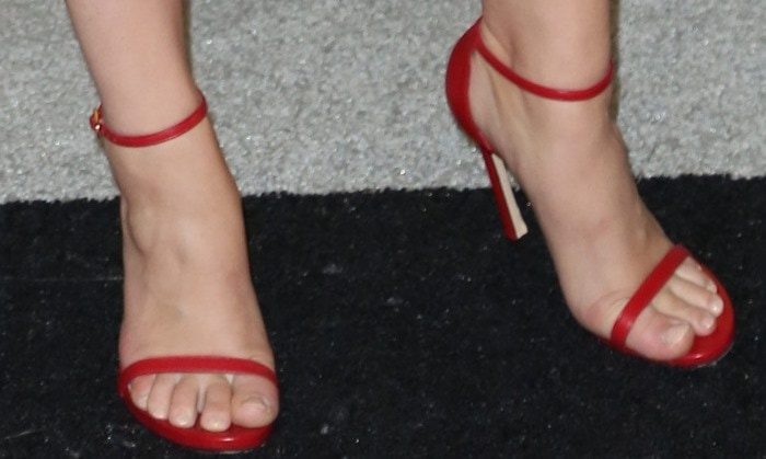 Holland Roden shows off her unpainted toenails in an all-too-common pair of Stuart Weitzman sandals