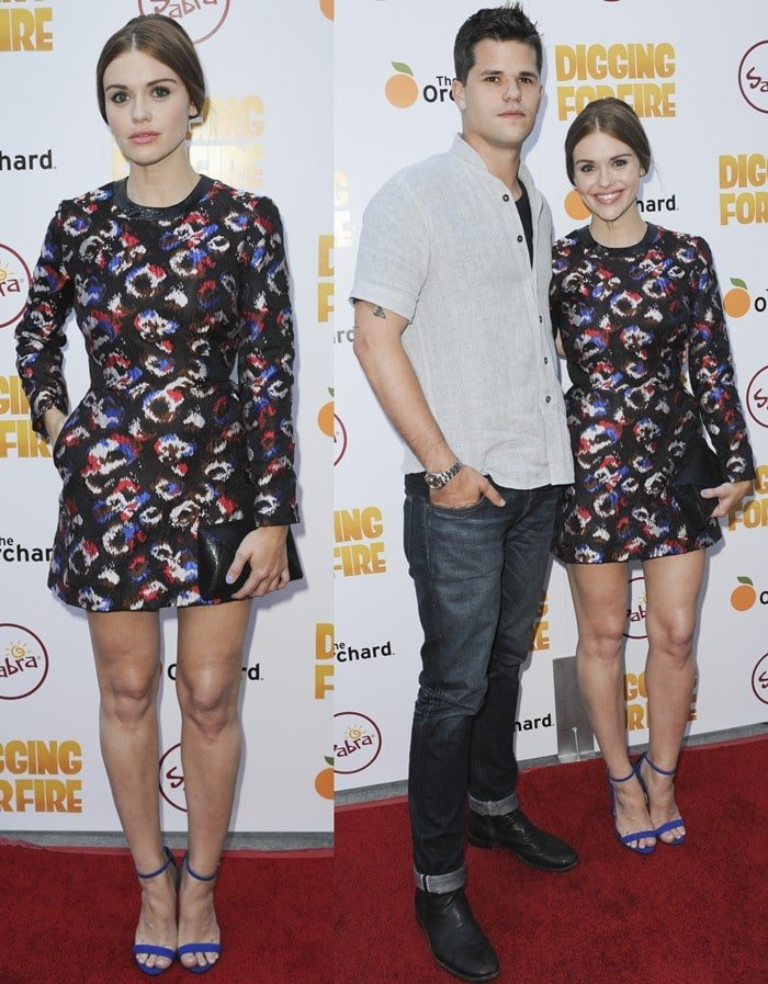 Holland Roden smiles as she poses with boyfriend and Teen Wolf co-star Max Carver on the red carpet