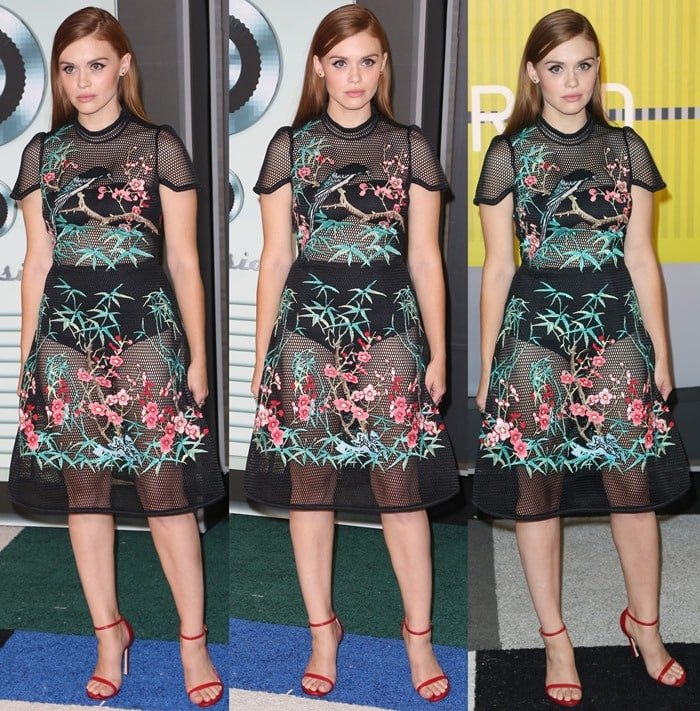Holland Roden shows off her outfit from head-to-toe on the carpet at the MTV Video Music Awards