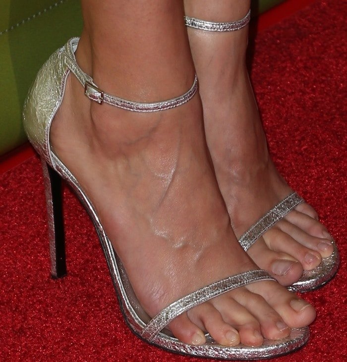 Jaimie Alexander's toes look bent and uncomfortable as they peek out from beneath the silver strap of her minimalistic sandals
