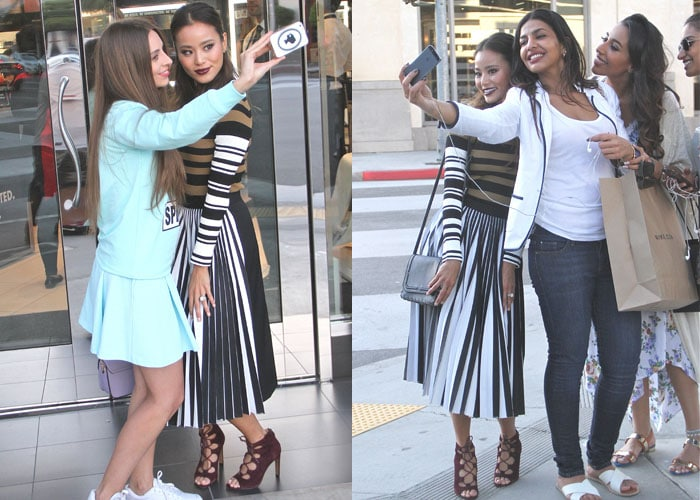 Jamie Chung poses for selfies with fans outside a Sephora storefront