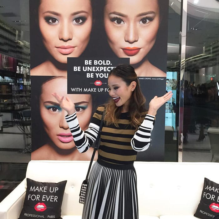 Jamie Chung shows off her heavy makeup by Make Up For Ever and her long dark waves