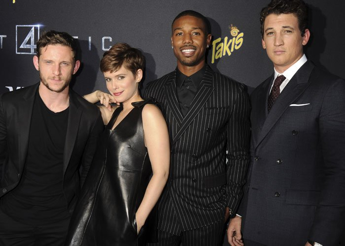Jamie Bell, Kate Mara, Michael B. Jordan, and Miles Teller pose for a photo on the red carpet at the Fantastic Four premiere