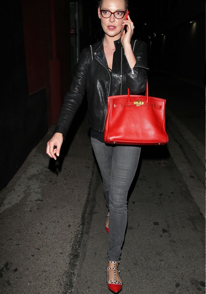 Katherine Heigl chats on the phone as she leaves a Los Angeles music venue