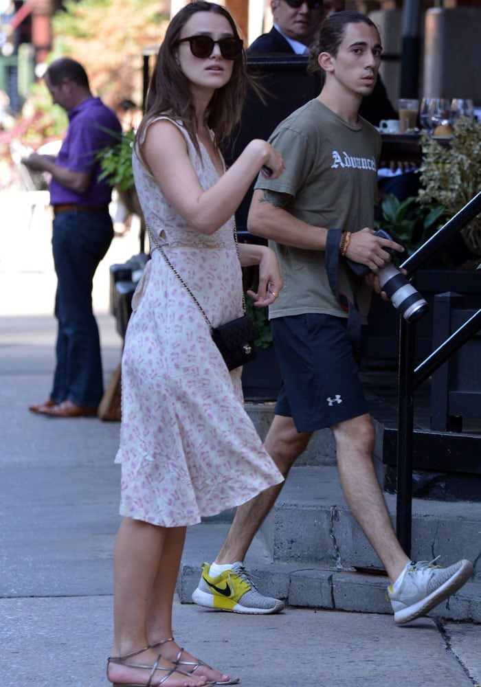 Keira Knightley ignores the paparazzi as she pauses on a New York sidewalk