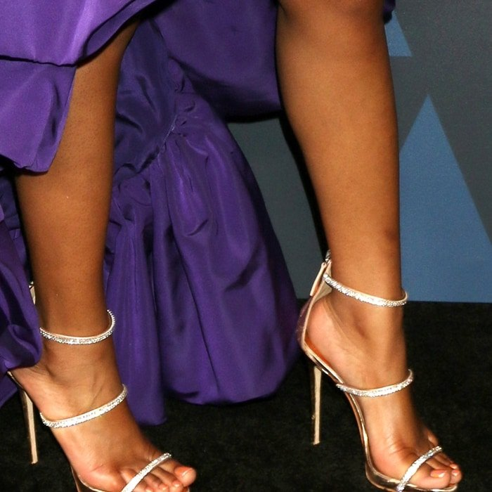 Keke Palmer's sexy feet in rose gold Harmony Sparkle three-strap sandals with crystals from Giuseppe Zanotti