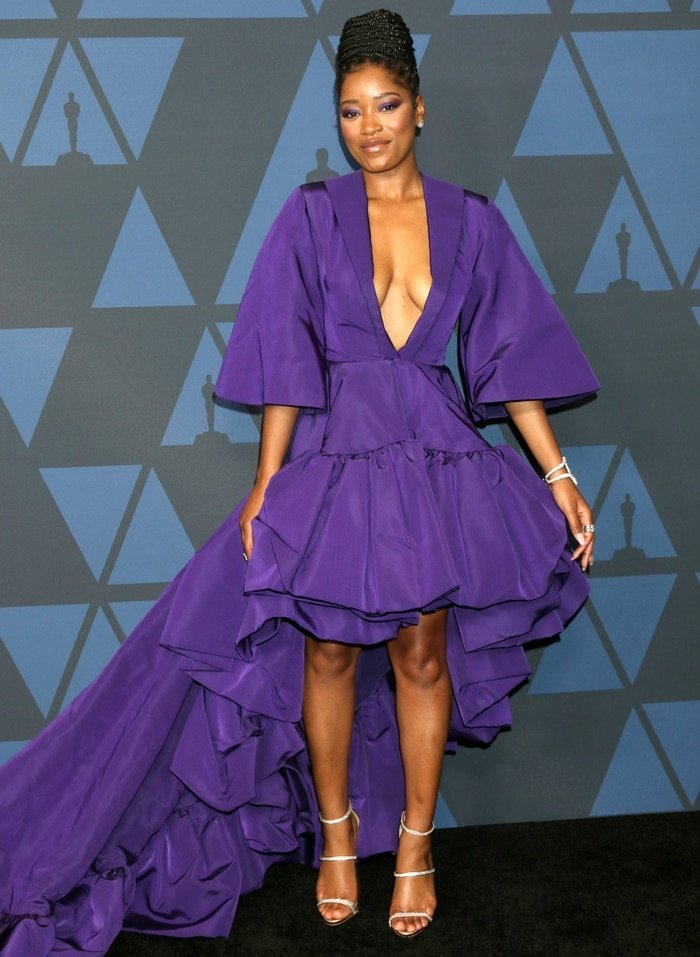 Keke Palmer flashed her legs in a royal purple dress at the 2019 Governors Awards