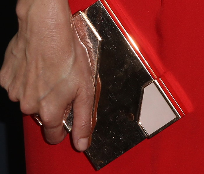 Lake Bell toted a shining Lee Savage clutch