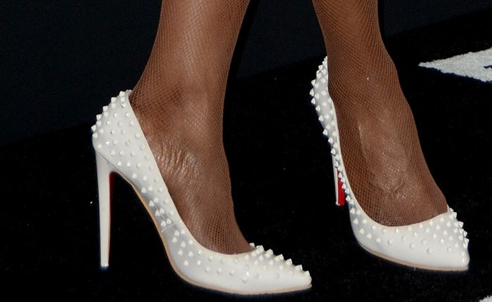 Laverne Cox's gigantic feet in white shoes and stockings