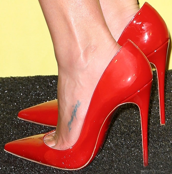Lea Michele wearing red patent Christian Louboutin 'So Kate' pumps