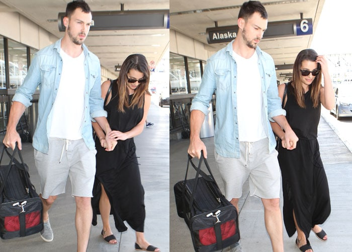 Lea Michele and boyfriend Matthew Paetz hold hands as they stroll through airport arrivals