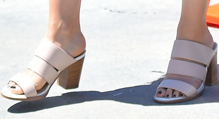 Lily Collins displayed her sexy toes in stacked heel sandals from Sol Sana