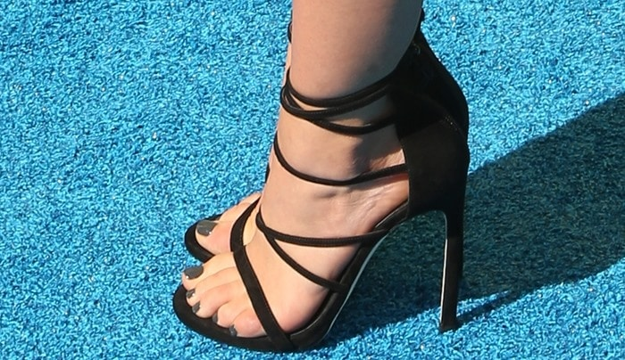Lucy Hale's sexy feet in strappy black sandals and a matching vampy pedicure