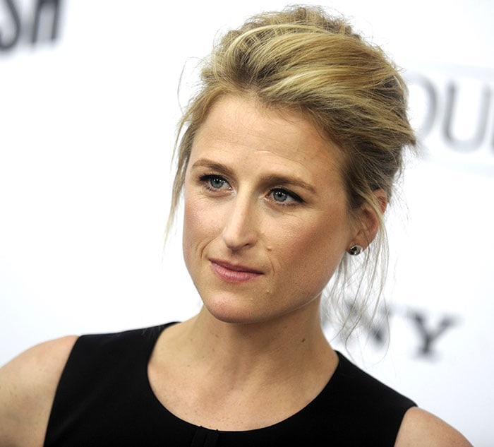 Mamie Gummer's blonde hair was swept up into a messy updo