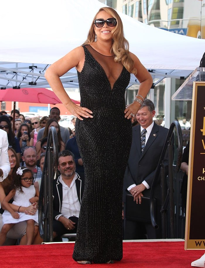 Mariah Carey donned a form-fitting floor-length beaded gown by Yousef Aljasmi