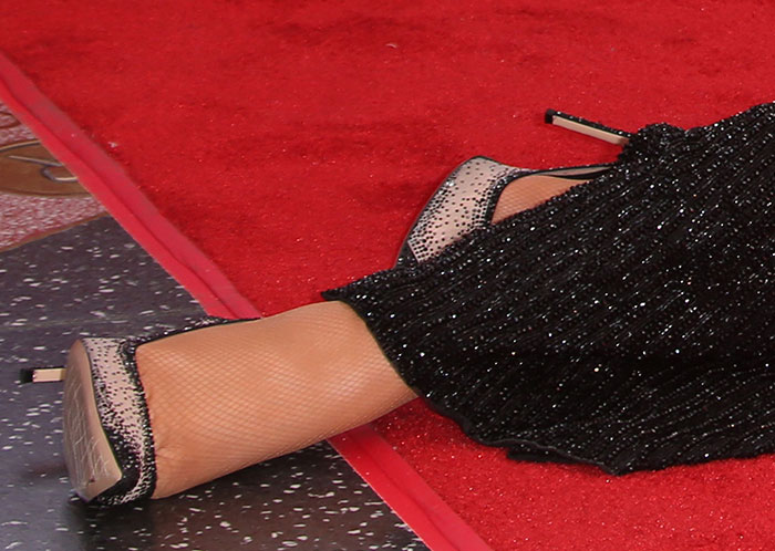Mariah Carey's shoes feature see-through mesh fabric
