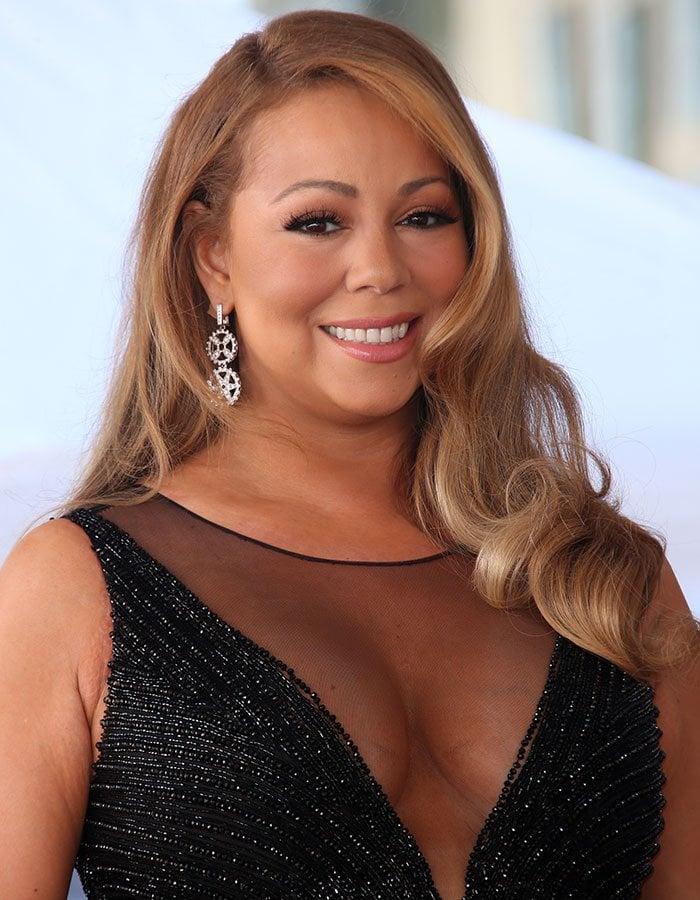 Mariah Carey's long hair was styled in loose curls