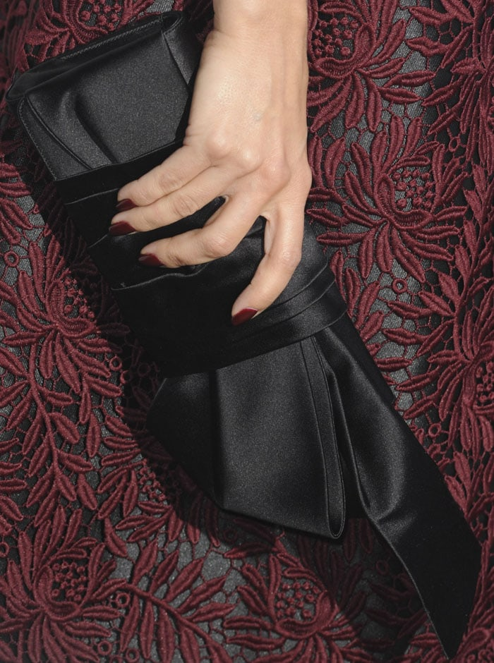 Mena Suvari matches her burgundy nails to the burgundy lace overlay of her cocktail dress, and her black clutch to the black lining of her frock