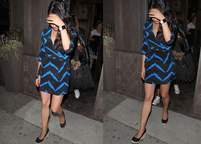 Mila Kunis shields her eyes from the paparazzi as she leaves a Los Angeles restaurant following her birthday dinner