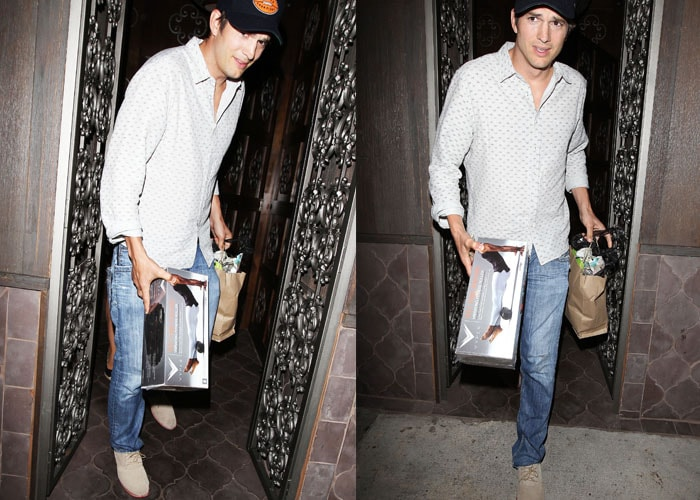Ashton Kutcher carrying the HyperIce Vyper vibrating fitness roller that he purchased for his wife Mila Kunis