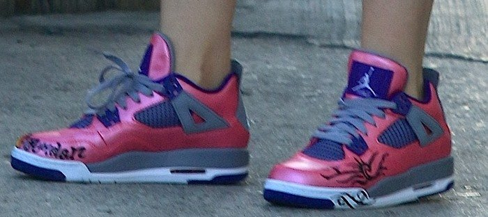 Miley Cyrus shows off the detail on her pink Nike sneakers
