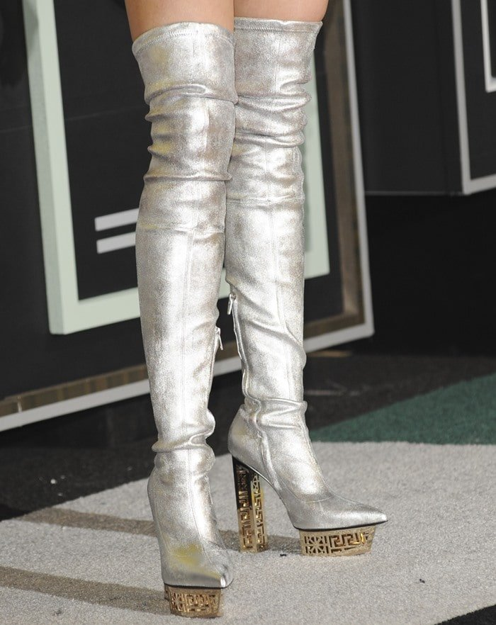 Miley Cyrus rocked silver thigh-high platform boots