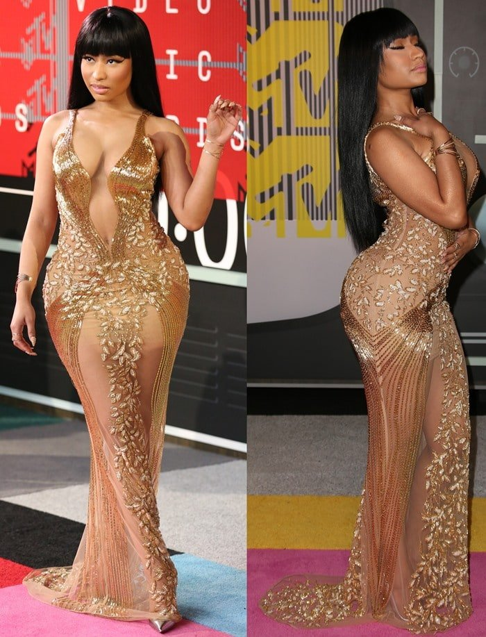 Nicki Minaj poses and shows off her pearl-embellished gown at the VMAs
