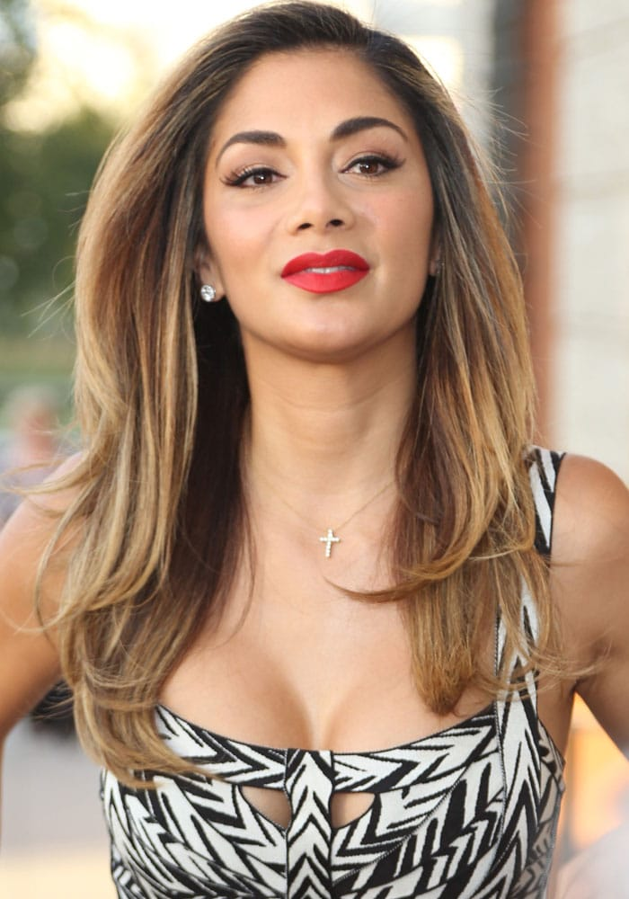Nicole Scherzinger exposes cleavage in yet another revealing dress