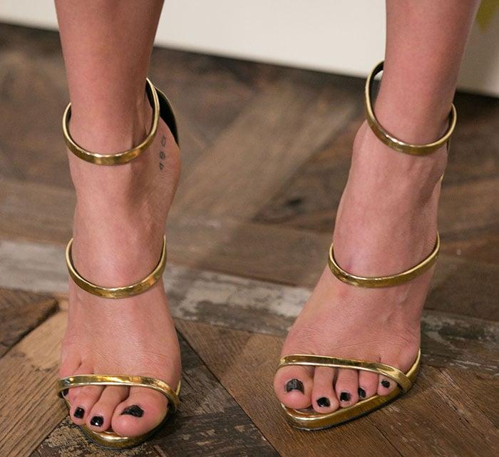 Nikki Reed's sexy feet in Giuseppe Zanotti sandals