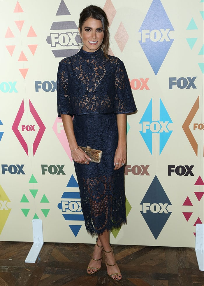 Nikki Reed flashed her legs in a two-piece navy blue floral lace outfit by Lover