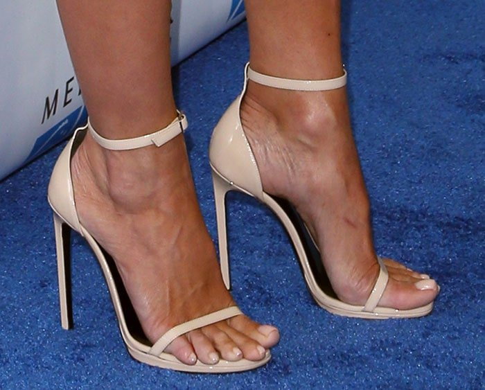 Pamela Anderson shows off her toes in Saint Laurent sandals