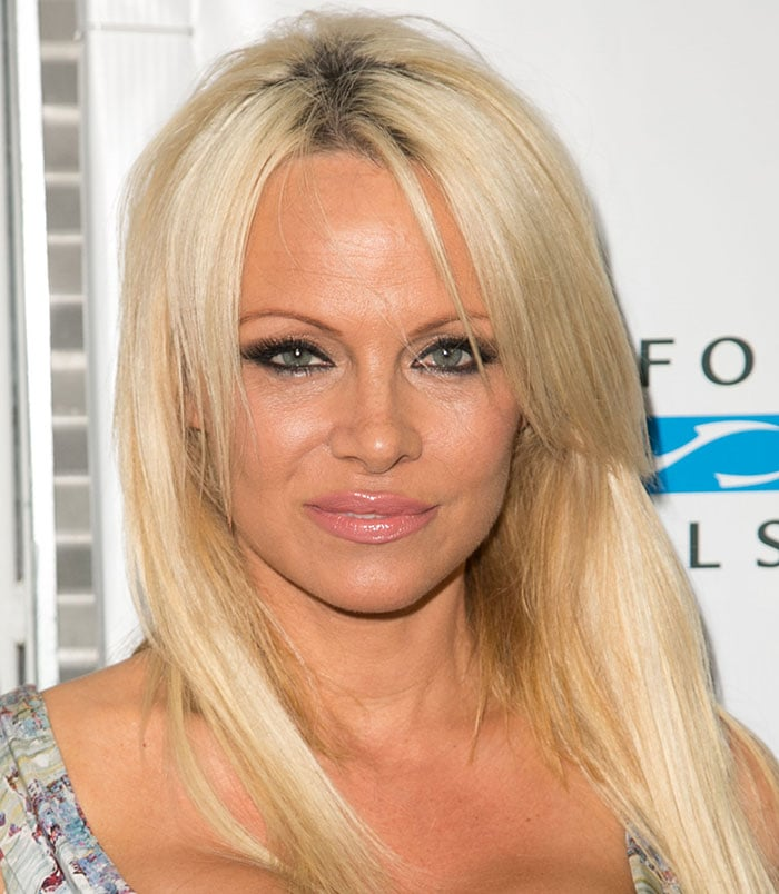 Pamela Anderson'sblonde locks, smoky eye makeup, and glossy pink lips were the finishing touches to her look