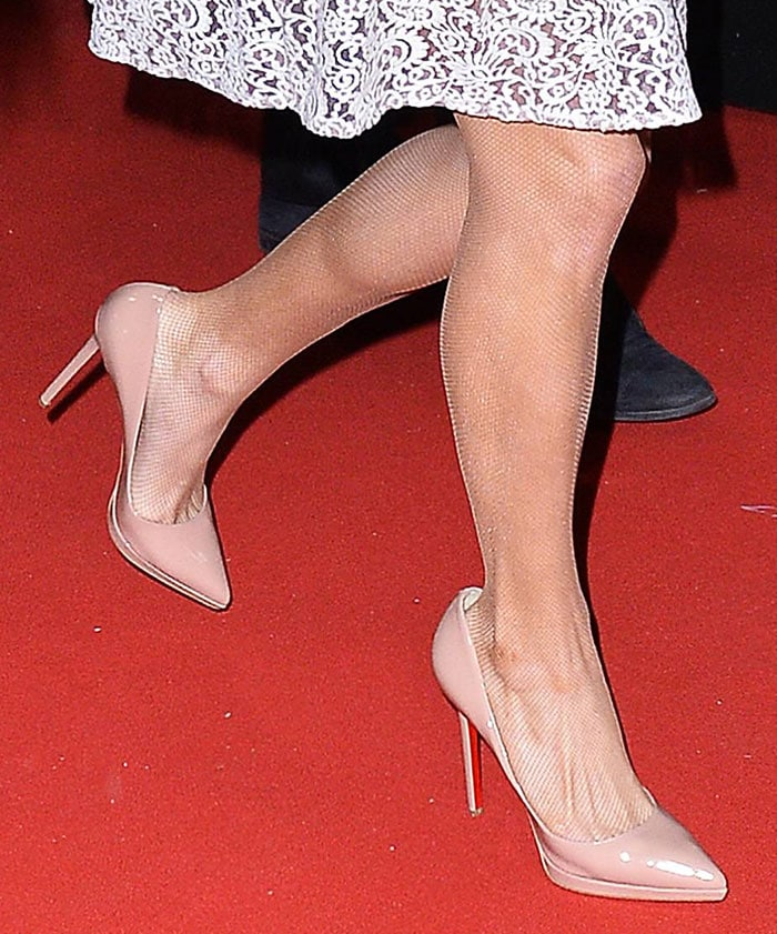 Paris Hilton styled her fishnet stockings with Christian Louboutin pumps