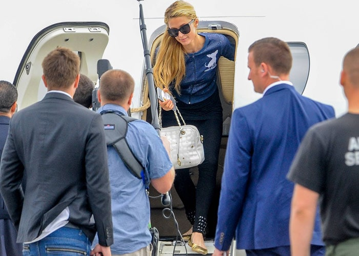 Paris Hilton exits her private jet in a custom ensemble as she arrives in Warsaw