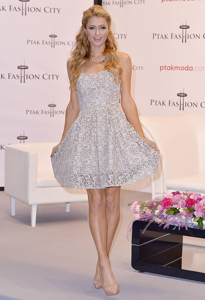 Paris Hilton flaunted her longs legs in a charming fit-and-flare lace dress featuring a cinched waist