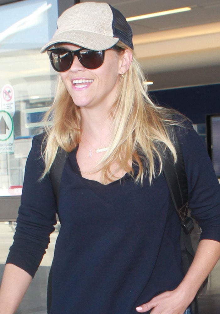 Actress and entrepreneur Reese Witherspoon arrives at Los Angeles International Airport