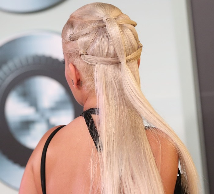 Rita Ora shows off her intricate half-up half-down blonde hairdo at the MTV Video Music Awards